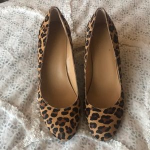 Covered leopard wedge heels